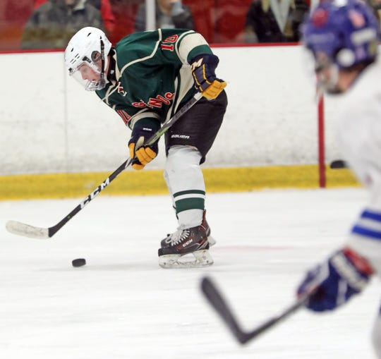 Rivertown's Ben Birkhahn (10) maintains control of the puck during Division 1 quarterfinal ice hockey at Brewster Ice Arena Feb. 25, 2020. Rivertown defeats Carmel 9-4.