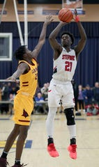 Stepinac's Adrian Griffin Jr. shoots over Cardinal Hayes' Julio Phipps during the CHSAA Archdiocesan tournament semifinals at Mount St. Michael Feb. 25, 2020. Stepinac won 68-63.
