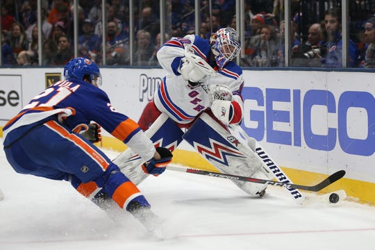 New York Rangers goalie Alexandar Georgiev (40) plays the puck against New York Islanders left wing Otto Koivula (21) during the second period at Barclays Center.