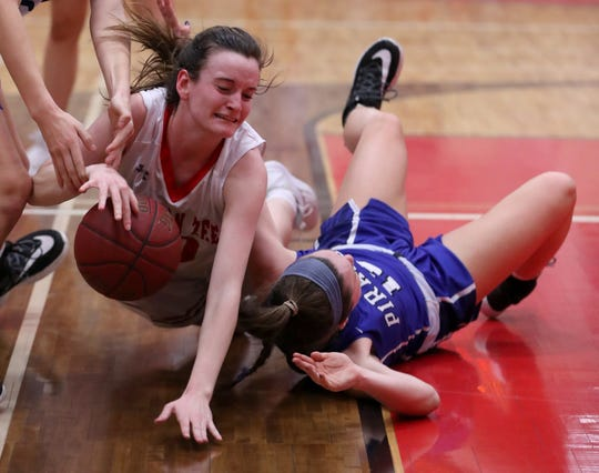 Tappan Zee's Kaleigh Beirne, left, fights for the ball with Pearl River's Maeve Woods during their playoff game at Tappan Zee Feb. 26, 2020.