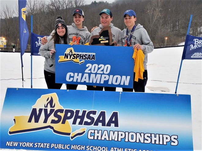 Coach Christine Crowley with Cole Lovejoy, Charlie Roseberry and Robby Lundberg at Bristol Mountain after the three won the 2020 boys state ski team title for Mamaroneck High School on Feb. 25, 2020
