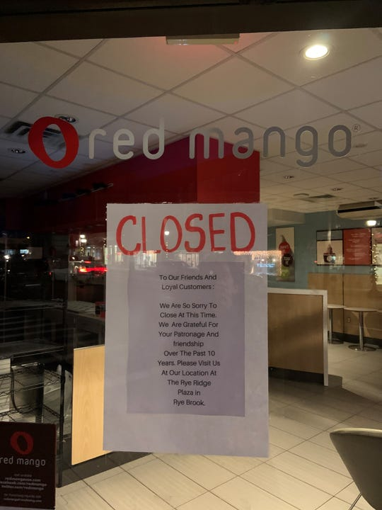 The sign at Red Mango in Larchmont announcing their closing.
