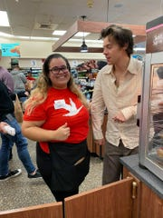 Singer Harry Styles prepares to take a photo with fan Natali Maldonado during her shift at a Bear Wawa ion Tuesday.