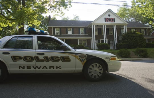A Newark police cruiser passes University of Delaware fraternity Kappa Sigma's house on Academy Street while on patrol in Newark on May 7, 2011.