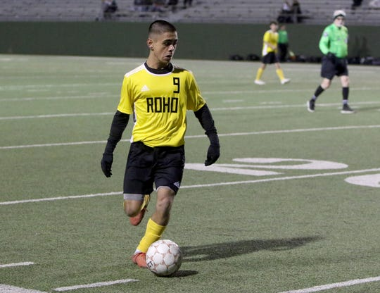 Rider's Hamza Ahmed dribbles in the match against Wichita Falls High Tuesday, Feb. 25, 2020, at Memorial Stadium.