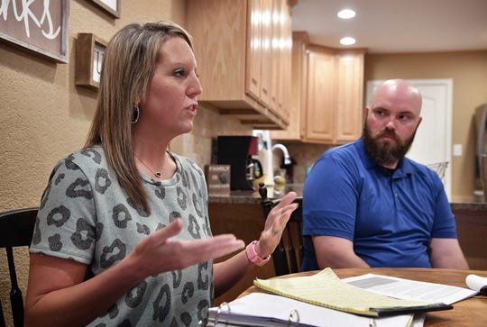 Chelsea Putney explains the steps she and her husband, Wichita Falls police officer Tim Putney, shown in this May 4, 2018, file photo, were going through to get surgery approved for her husband's on-the-job injuries.