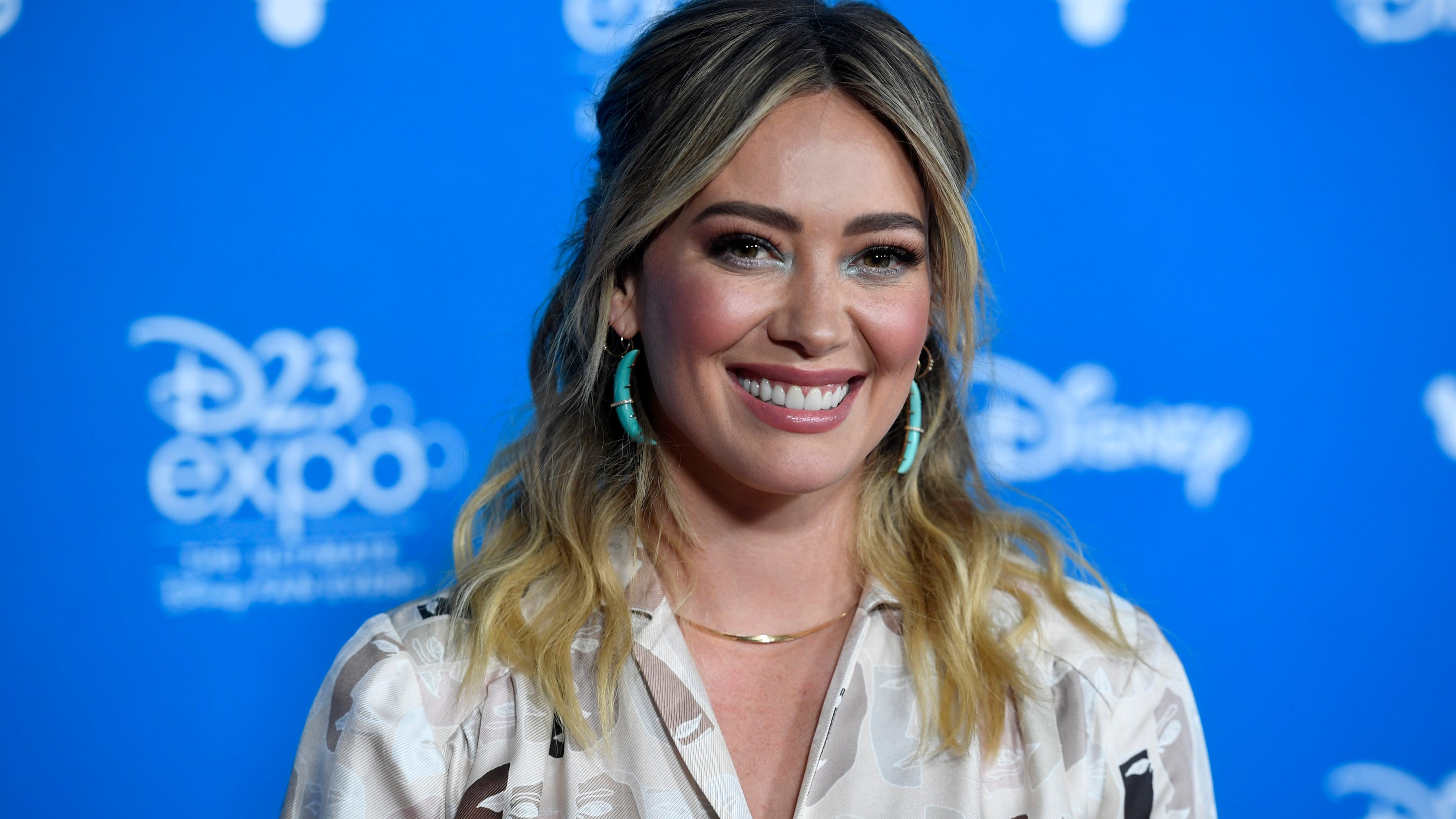 Hilary Duff confronts photographer taking pics at son's game: 'This is stalking minors' thumbnail