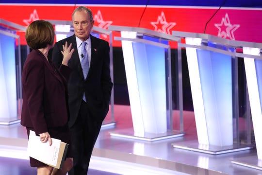 Democratic presidential candidate Sen. Amy Klobuchar (D-MN) and former New York City Mayor Mike Bloomberg speak after the Democratic presidential primary debate.