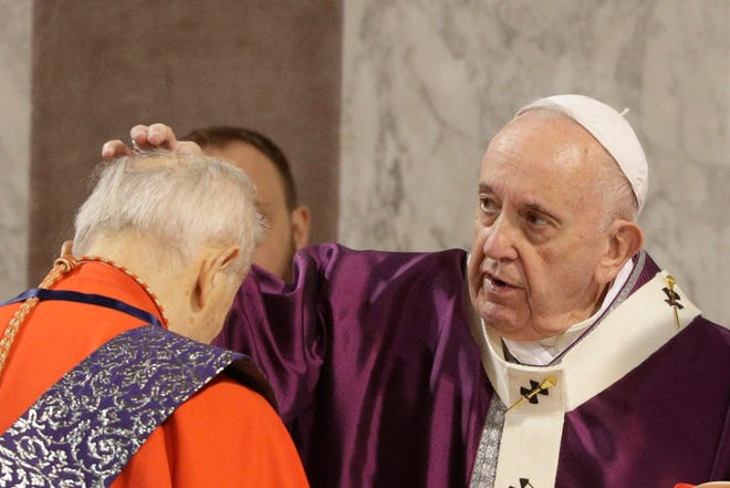 Pope Francis puts ashes on the forehead of Cardinal Jozef Tomko in the Santa Sabina Basilica during the Ash Wednesday Mass opening Lent, the forty-day period of abstinence and deprivation for Christians before Holy Week and Easter. (AP Photo/Gregorio Borgia)