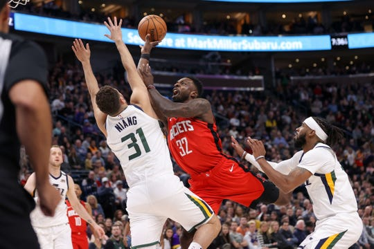 Houston Rockets forward Jeff Green (32) shoots the ball over Utah Jazz forward Georges Niang (31) during the first quarter at Vivint Smart Home Arena.