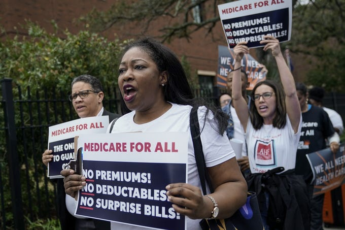 "Supporters of ""Medicare For All"" demonstrate outside of the Charleston Gaillard Center ahead of the Democratic presidential debate on Feb. 25, 2020 in Charleston, S. C. South Carolina holds its Democratic presidential primary on Saturday, February 29."