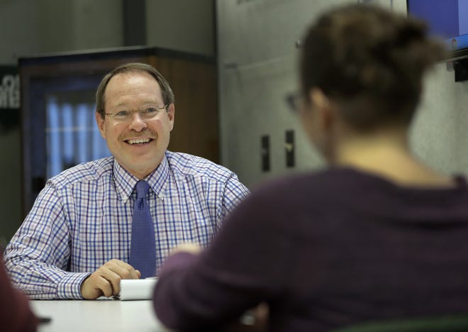 Appleton health officer Kurt Eggebrecht discusses an issue with public health nurse Jessica Moyle on Feb. 26. A few short months later, as the coronavirus engulfed the state, Eggebrecht announced he would postpone his retirement to lead the city through the pandemic.