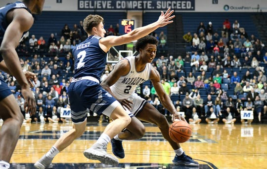 Monmouth junior Melik Martin drives to the basket against Saint Peter's at OceanFrist Bank Center in West Long Branch earlier this season.