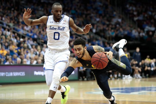 Marquette Golden Eagles guard Markus Howard (0) reacts as Seton Hall Pirates guard Quincy McKnight (0) defends during the first half at Prudential Center.