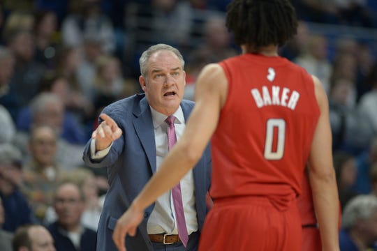 Rutgers coach Steve Pikiell gives some instructions to Geo Baker (0) during the first half of an NCAA college basketball game against Penn State, Wednesday, Feb. 26, 2020, in State College, Pa.