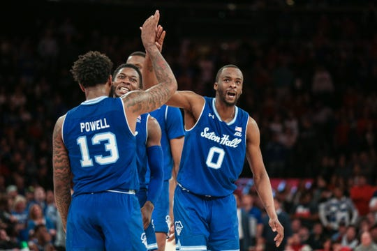 Seton Hall Pirates guard Quincy McKnight (0) and guard Myles Powell (13) celebrate after a basket during the second half against the St. John's Red Storm at Madison Square Garden.