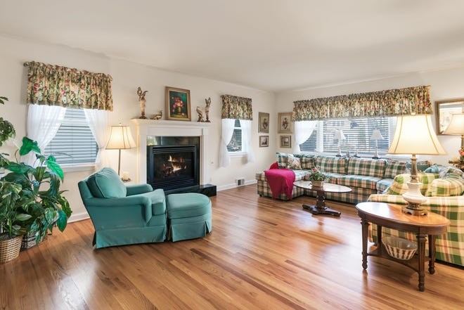 There are hardwood floors and a fireplace in the home.