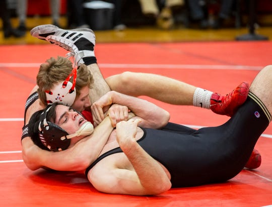 Point Pleasant Beach's Kip Lovgren (left) puts Burlington Township's  Alex DeAngelis to his back in their 138-pound bout in the NJSIAA Region VI Tournament Wednesday night. Lovgren pinned with one second left in the first period. .