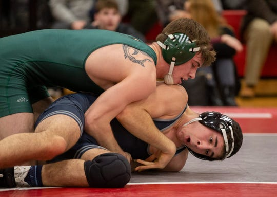 Long Branch's Ryan Carey (top), shown defeating Christian Brothers Academy's Mason Garber Wednesday night in a Region VI Tournament 152-pound pre-quarterfinal-round bout, will wrestle Delran's Eren Ibas in an interesting Region VI quarterfinal-round Friday night at Jackson Liberty.