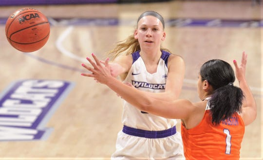 ACU's Breanna Wright, left, passes the ball past Sam Houston State's Jenniffer Oramas in the first half. ACU beat the Bearkats 94-91 in the Southland Conference game Wednesday, Feb. 26, 2020, at Moody Coliseum.