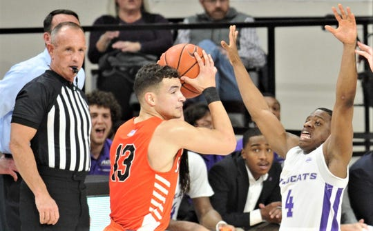ACU's Damien Daniels, right, defends against Sam Houston State's Dainian Swoope in the first half.