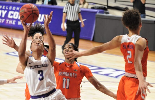 ACU's Dominique Golightly (3) drives in the paint in the first half as Sam Houston's Courtney Cleveland (11) and Amber Leggett (2) defend. ACU beat the Bearkats 94-91 in the Southland Conference game Wednesday at Moody Coliseum.