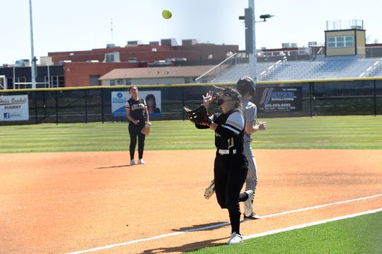 Abilene High first baseman Jazzy Cantu (10) looks in a pop up during Thursday's game against Clyde in the Abilene Ice Breaker. Cantu is taking over for one of eight seniors the Lady Eagles graduated last season.