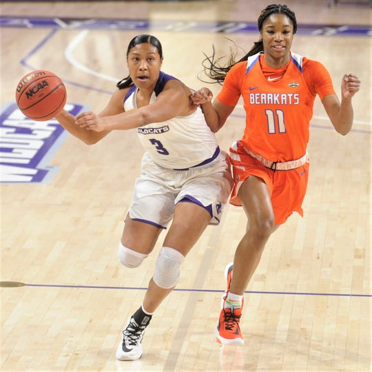 ACU's Dominique Golightly (3) brings the ball up court as Sam Houston State's Courtney Cleveland defends in the first half.