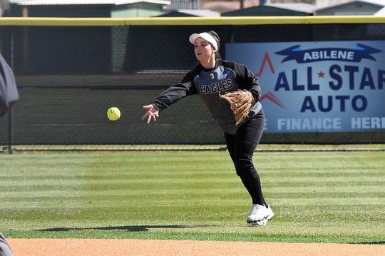 Abilene High left fielder Teá Jimenez (3) tosses the ball back to the infield during Thursday's game against Clyde in the Abilene Ice Breaker. Jimenez is one of six new starters for the Lady Eagles this season.