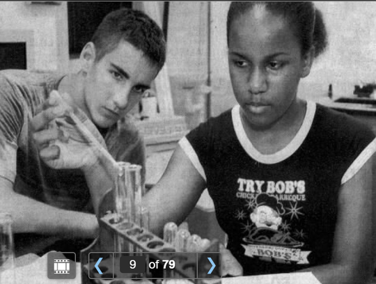 A KIPP Asheville student (right) works with an Asheville School student (left) during a summer enrichment program in the mid-2000s.