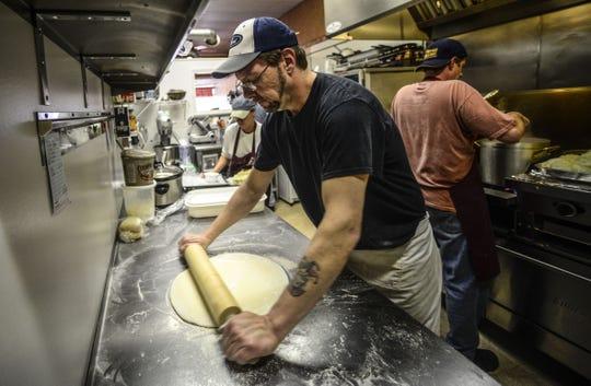 Dan McLarney, owner of Czech Pleeze in Binghamton, makes fresh pirohi in his kitchen in 2014.