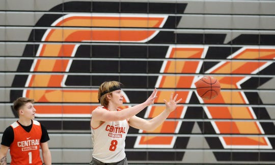 Central Kitsap's Owen Boisen prepares to grab a pass during boys basketball practice Feb. 26 at the high school. The Cougars face Shorecrest on Saturday in a Class 3A regional playoff game.