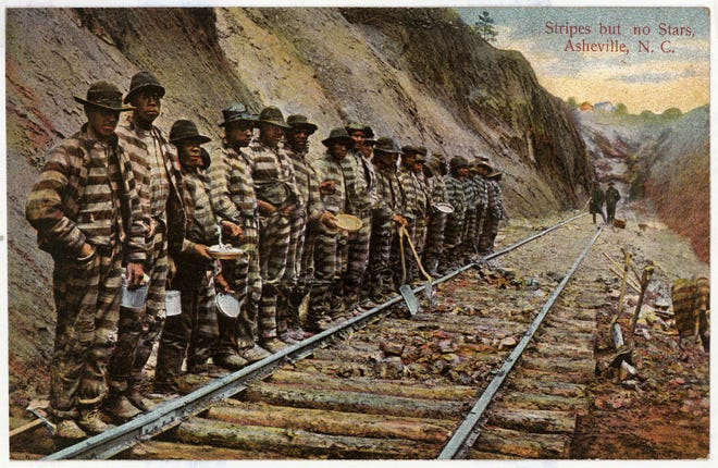 In 1875, in an effort to cut costs, the Western North Carolina Railroad began leasing convicts to help lay track from Old Fort to Asheville. Some of the convicts are seen in this historic postcard.
