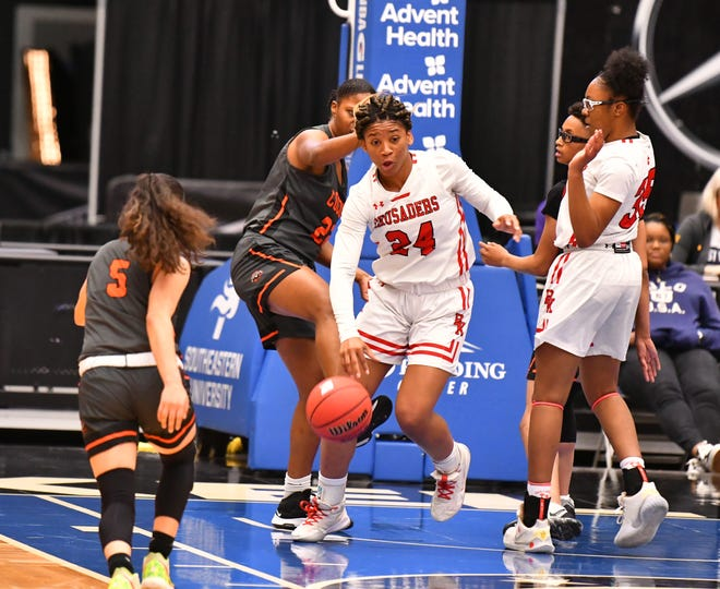 Bishop Kenny's Jasmyne Roberts (24, center) takes possession against Cocoa in last year's girls basketball state semifinal. Roberts, a Miami signee and the reigning All-First Coast player of the year, leads the Crusaders into her senior season.