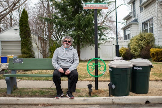 """Greg """"Big Daddy"""" Conklin poses on his bench in front of his home in Gloucester City."""