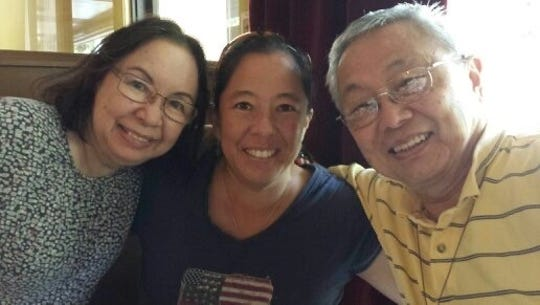 Liz Tchou (center) with her mother, Anna Tchou (left) and father John Tchou. Liz was a field hockey star at Shawnee High School and was an All-American at the University of Iowa and a member of the 1996 U.S. Olympic field hockey team. She currently is the senior manager of coach education for USA Field Hockey.