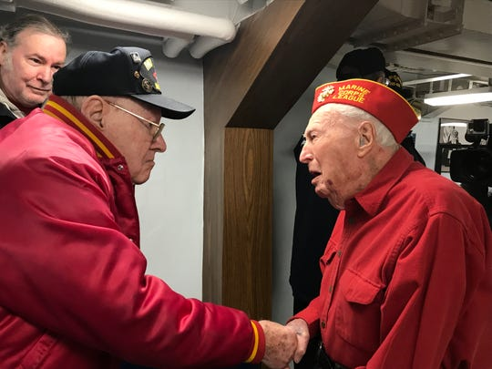 Two World War II veterans of the Battle of Iwo Jima meet in person for the first time on the 75th anniversary of the  battle this week and at a ceremony aboard the battleship New Jersey in Camden, where former Marines Frank Beach of Oaklyn, left, and John Welsh of Gloucester Township were honored as Beach's  son, Larry, watches.