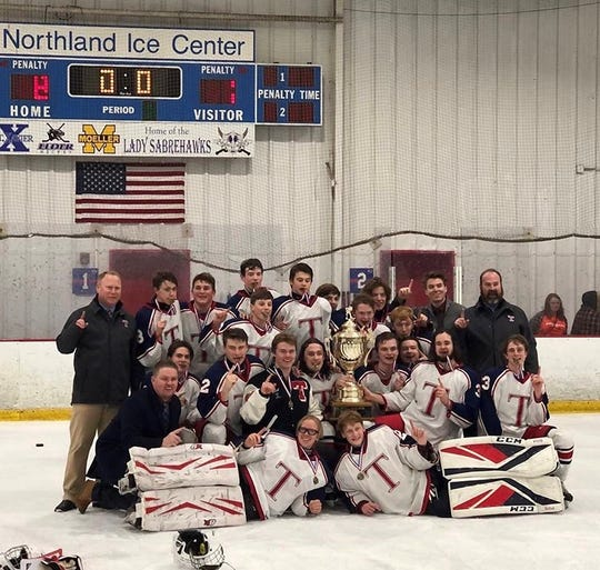Talawanda hockey celebrates its Southwest Ohio High School Hockey League tournament title after beating Beavercreek 8-1 Feb. 16, 2020.