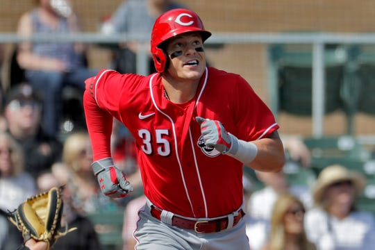 Cincinnati Reds' Derek Dietrich watches his solo home run take flight against the Arizona Diamondbacks during the second inning of a spring training baseball game, Thursday, Feb. 27, 2020, in Scottsdale Ariz.