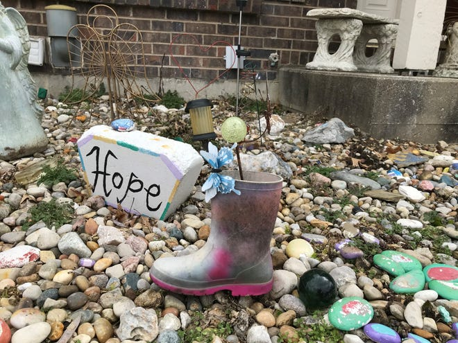 Jakyra Cundiff's size one boot is a centerpiece in Jenni McBride's Alexandria front yard garden memorial to her eight-year-old granddaughter and her daughter Desirae Hensley. Hensley and Cundiff were killed March 3, 2016, in a head-on collision. A Campbell County jury found the driver of the second car, Tammy Feinauer, guilty of reckless homicide in January 2020.