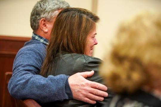 Archie Bird and Mary Bird, parents of defendant Quentin Bird, embrace as court returns to session at the Montgomery County Courthouse in Clarksville, Tenn., on Feb. 26, 2020.