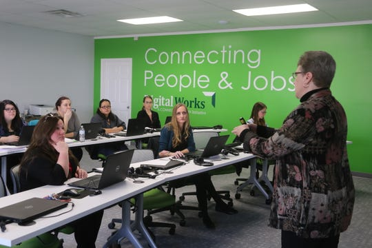 Digital Works operations manager Tammy Spring speaks with the first class to graduate from their certificate program geared toward military spouses at Fort Campbell on Feb. 27, 2020.