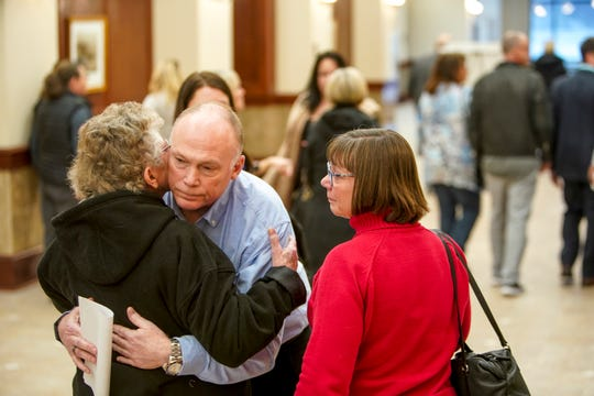 Family members of Allison Tenbarge embrace in the hallway after the jury delivered its verdict Feb. 26, 2020, at the Montgomery County Courthouse in Clarksville, Tenn.