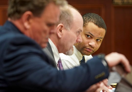 Quentin Bird listens to attorney James Phillips before the jury entered the room to deliver its verdict Feb. 26, 2020, at the Montgomery County Courthouse in Clarksville, Tenn.