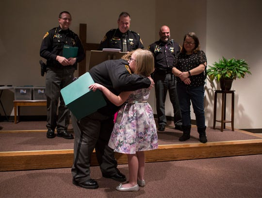 Deputy Denise Stotts hugs Cameille Leist who won a civilian award for her calm action in talking with dispatch to help save her mom's life. Leist was honored at the biennial sheriff's awards ceremony.