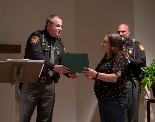Coshocton County Sheriff Timothy Rogers presents Tresa McClain with a Civilian Award at the Sheriff's Office awards ceremony.