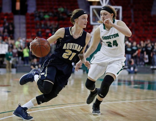 Aquinas' Lexi Donarski drives toward the basket while being guarded by Shiocton's Tina Ubl during the second half of a Division 4 semifinal of the WIAA girls' state basketball championships Thursday, March 9, 2017, in Green Bay, Wis. Donarski will play at Iowa State.