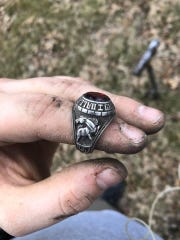 Garrett Seuser was using his metal detector near a home in Plainville, Kansas when he found a class ring belonging to a Dallas-Grimes High School student about five inches underground.