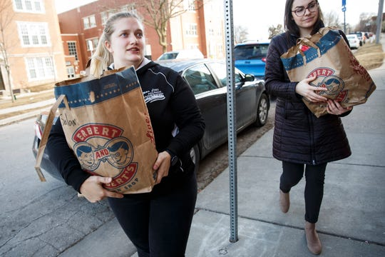 Drake senior Aspen Walters, right, and sophomore Ashly Frazier, left, deliver food to Children and Family Urban Movement on Wednesday, Feb. 26, 2020, in Des Moines. Walters and Frazier are part of Next Course, a food recovery program that takes leftover food from the campus dining halls to local shelters that can redistribute it.