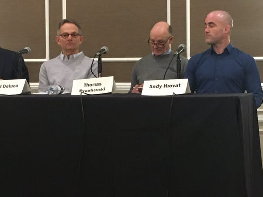 Three former University of Michigan wrestlers speak at a press conference accusing Dr. Robert Anderson of sexual assault.